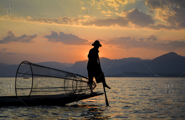 Burmese fisherman on Inle Lake at sunset