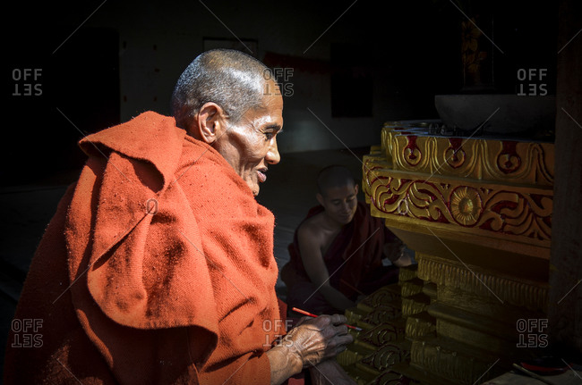 Inle lake, Myanmar, Burma - January 21, 2014: Buddhist monk painting an altar
