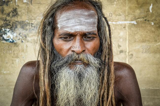Varanasi, India - November 12, 2014: Indian sadhu (holy man) in Varanasi