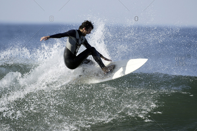 Surfer riding on wave