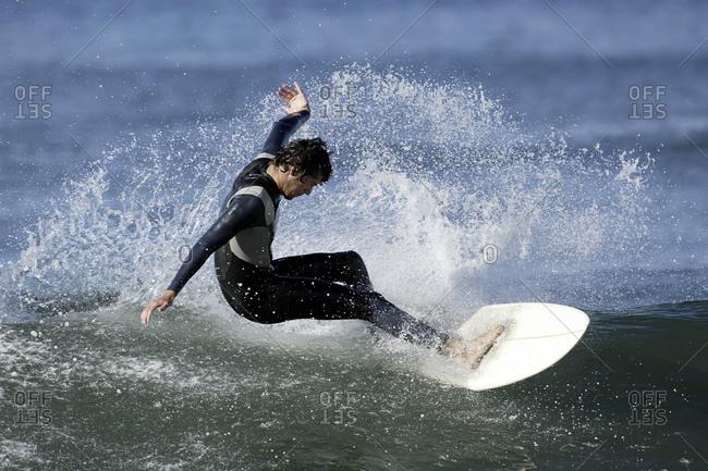 Surfer cutting back on wave