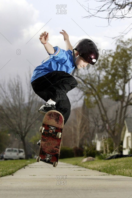 Young boy rides his skateboard