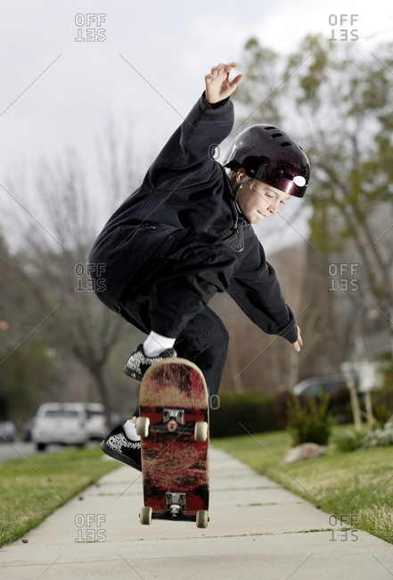 Young boy rides his skateboard