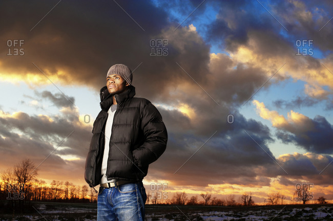 Man looking out against sunset