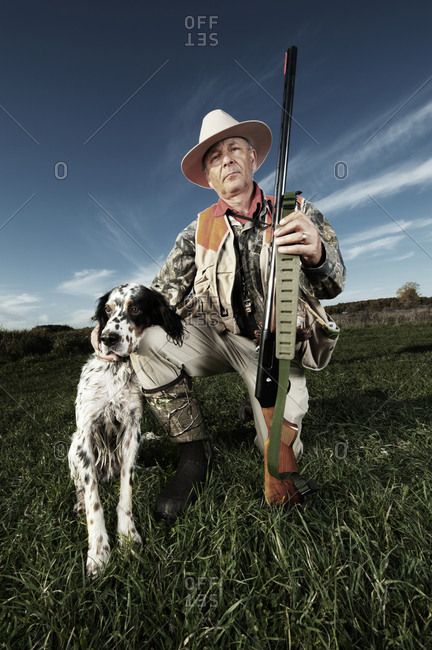 Hunter kneeling with dog