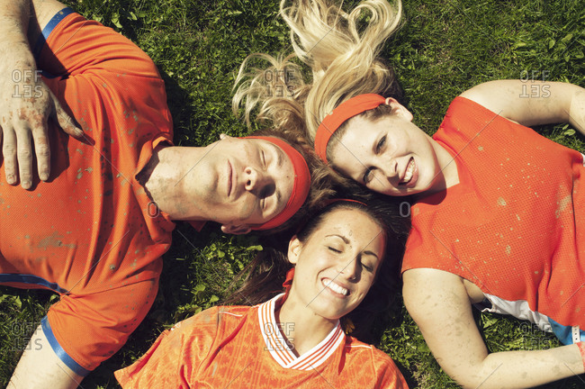 Soccer players lying on ground