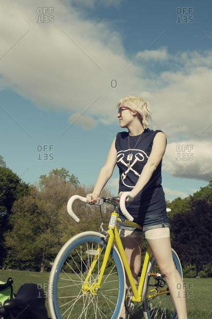 Woman resting on bike