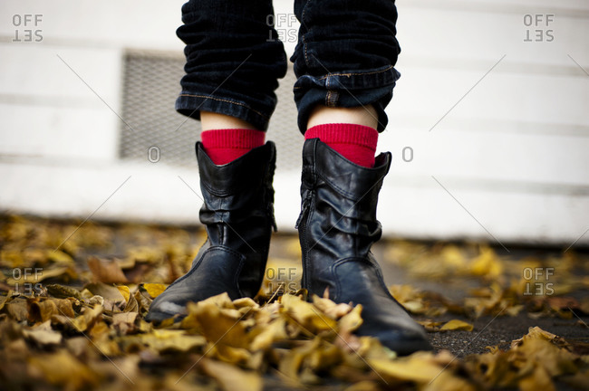 Close up of girl's boots in fall