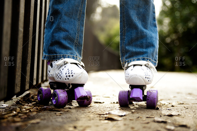 Close up of child's feet in roller skates
