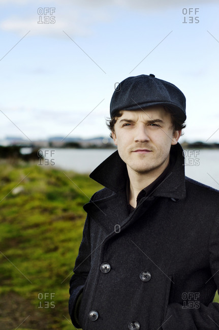 Portrait of man by river in pea coat
