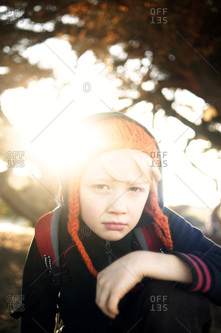 Portrait of young boy glaring at camera