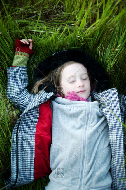 Young girl relaxing in tall grass