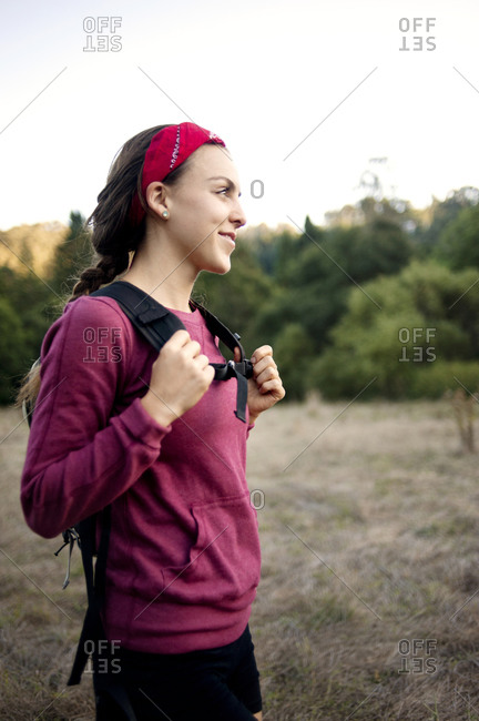 Woman hiking through with hydration pack