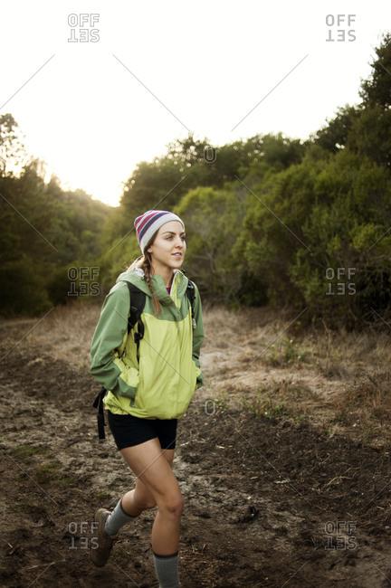 Woman hiking on muddy trail