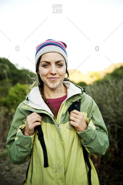 Portrait of young woman on hiking trail