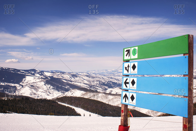 Signpost pointing to various ski slopes