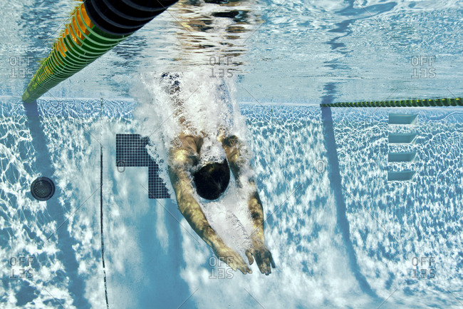 A man dives into pool