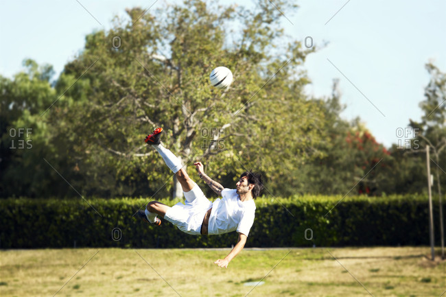 A soccer player doing a bicycle kick