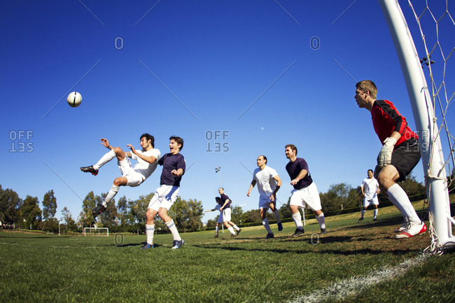 Friends playing a pick up game of soccer