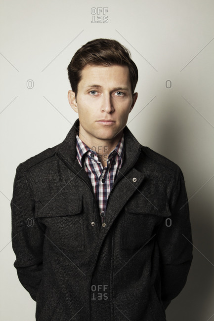 A young man wearing a jacket