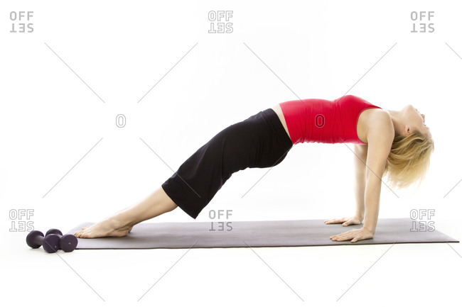 A woman stretches her back