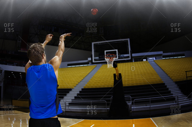 A man shooting a basketball