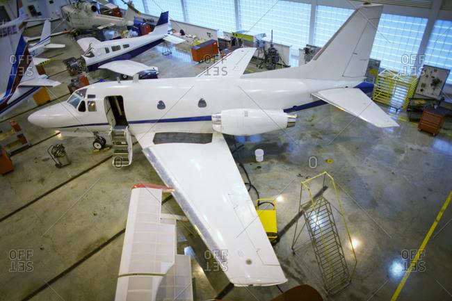 Refurbished private jets in a repair hangar