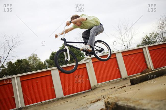 biker jumping off a ledge