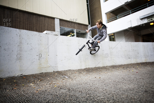Biker committing to a wall ride