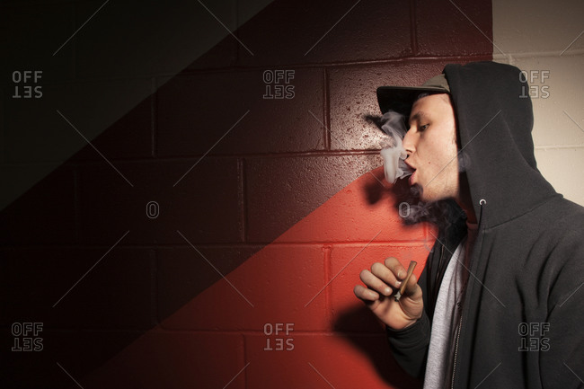 A young man smoking a blunt