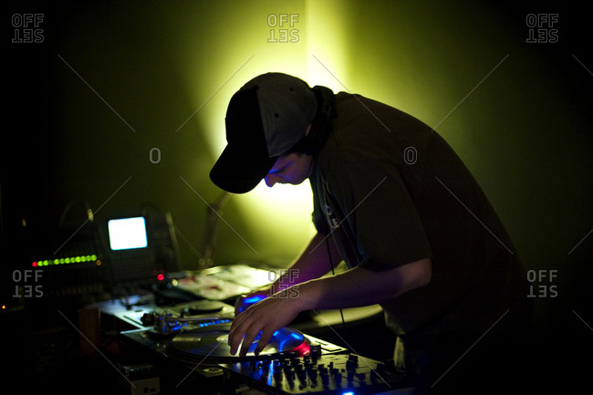 A DJ spinning records at party