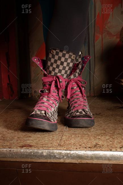 Girl wearing checkered hightops