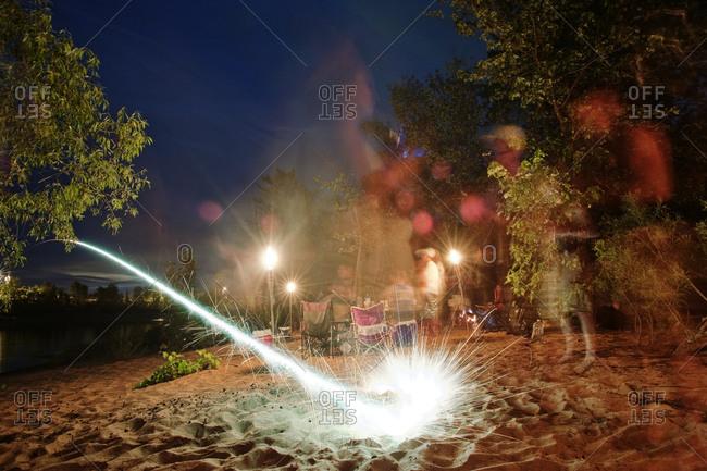 Bottle rocket launch at campsite