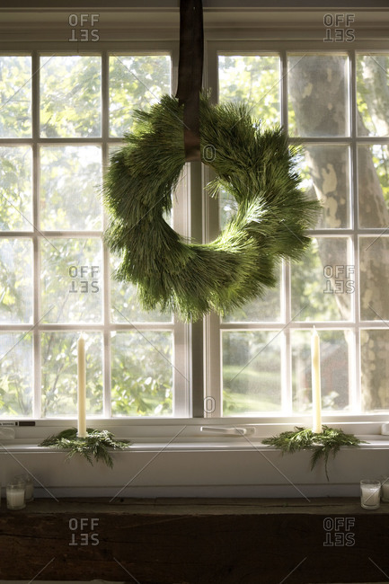A wreath hanging in a window