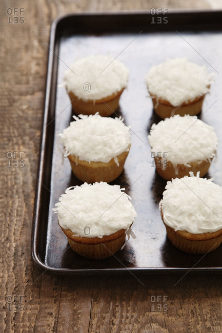 Coconut cupcakes on a pan