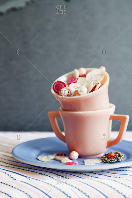 A teacup full of buttons