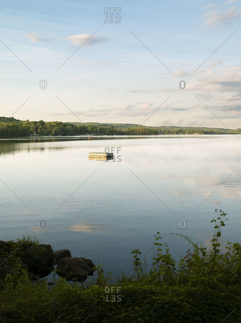 A floating dock the middle of the lake