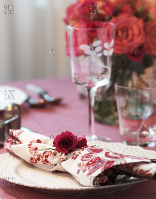 A table setting with roses