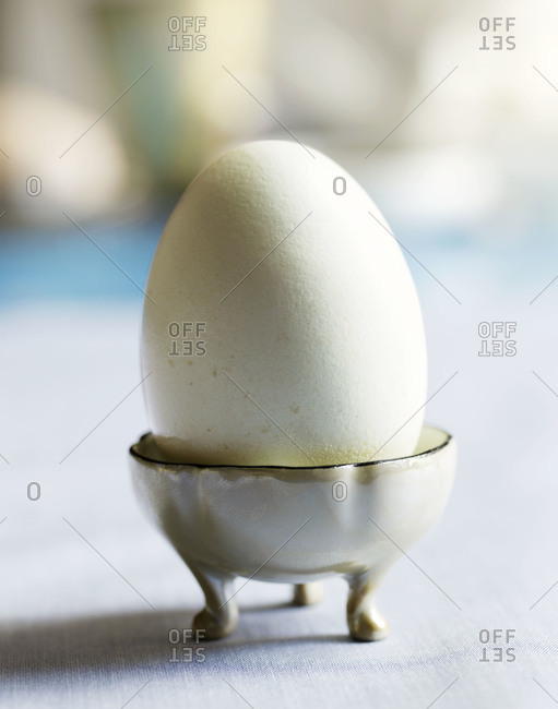 A hard boiled egg in an egg cup