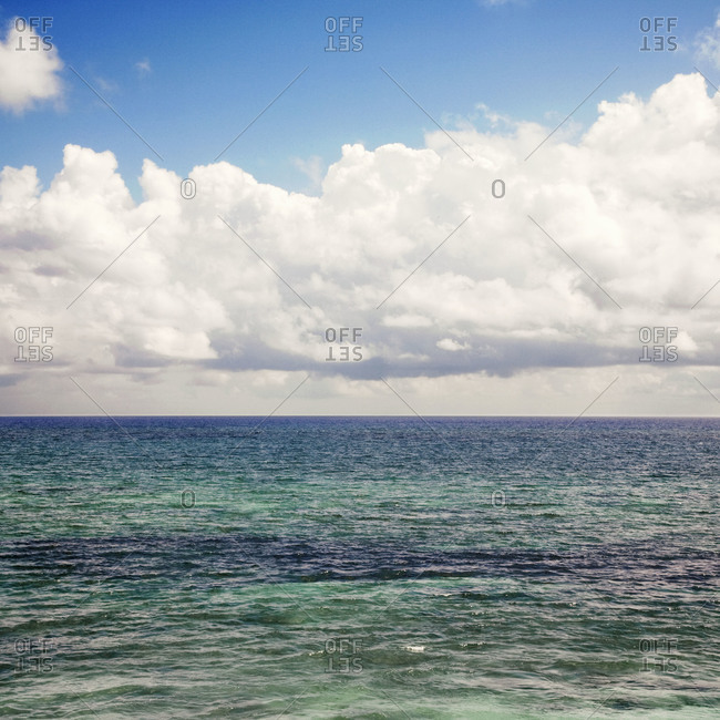 White billowy clouds over the ocean