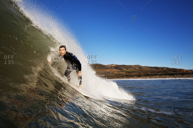 Man riding the curl of a wave