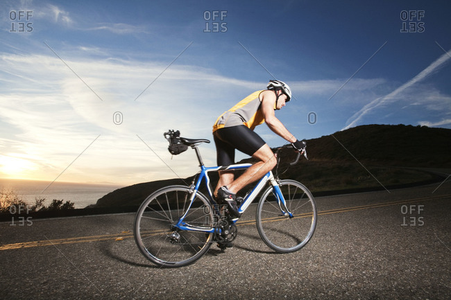 Man climbing hill on bicycle