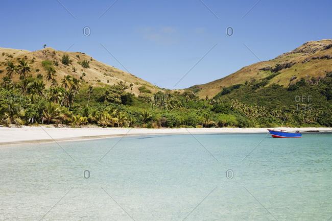 Boat anchored off White Sand Beach in Fiji