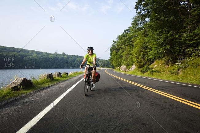 Woman riding bike in Harriman State Park
