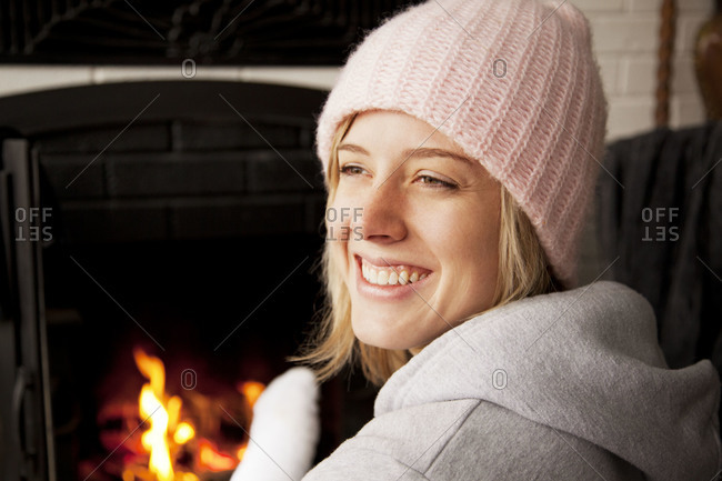 Girl smiling in front of fireplace