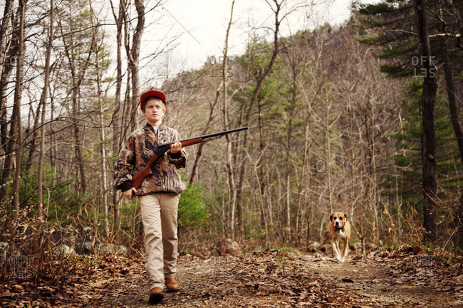 Young hunter with dog in Virginia woods