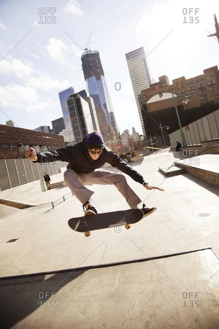 Skateboarder doing trick in skate park
