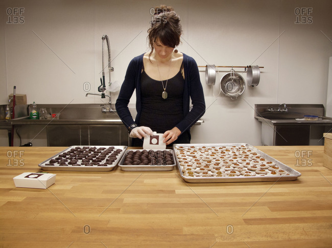 Woman preparing pastries in kitchen