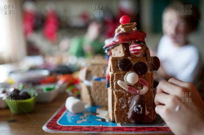 Children build a gingerbread house