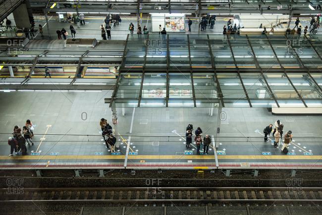 Osaka, Japan - December 20, 2014: People waiting in train station in Osaka